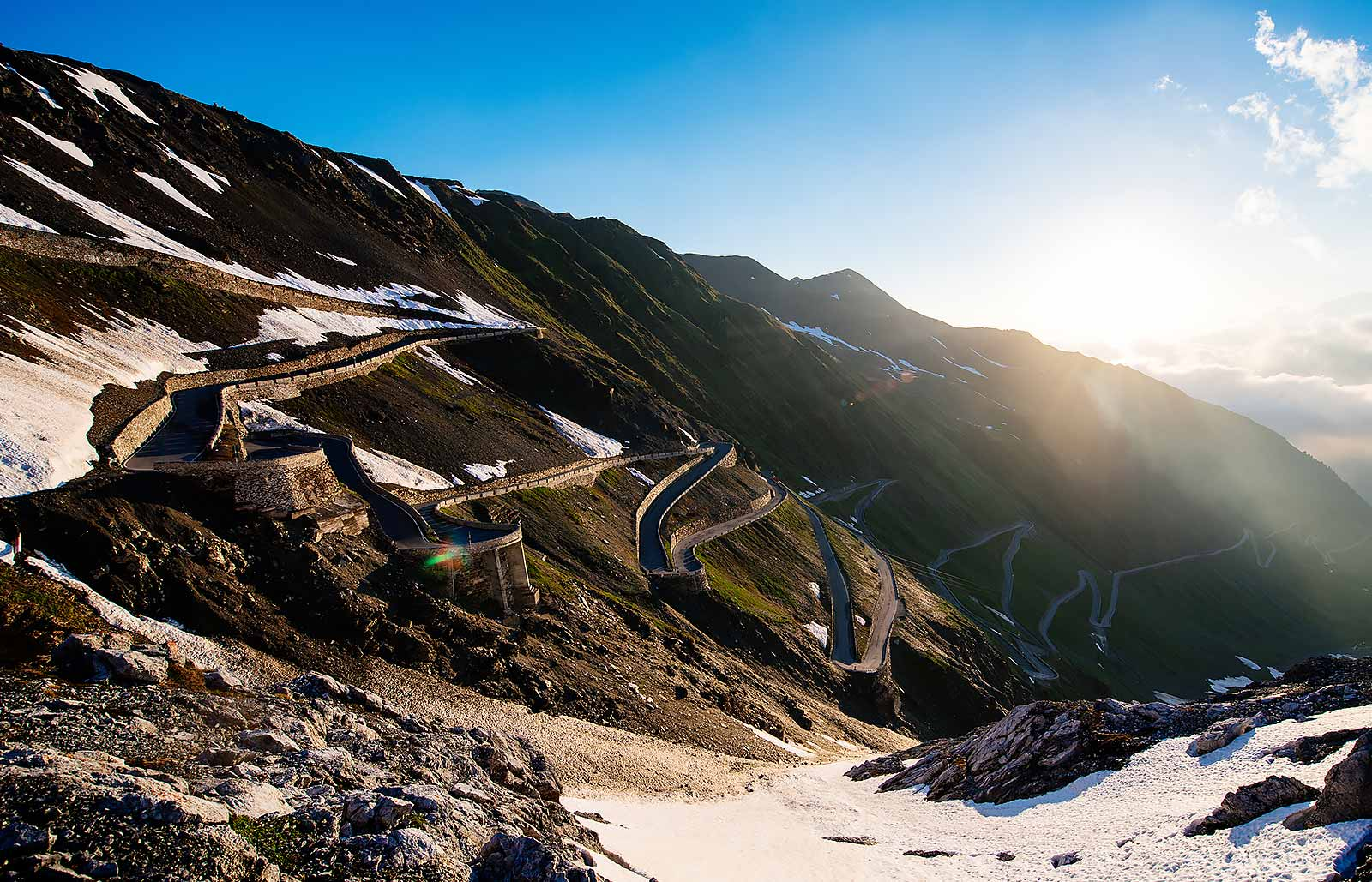 The winding road that leads to passo dello Stelvio covered with little snow